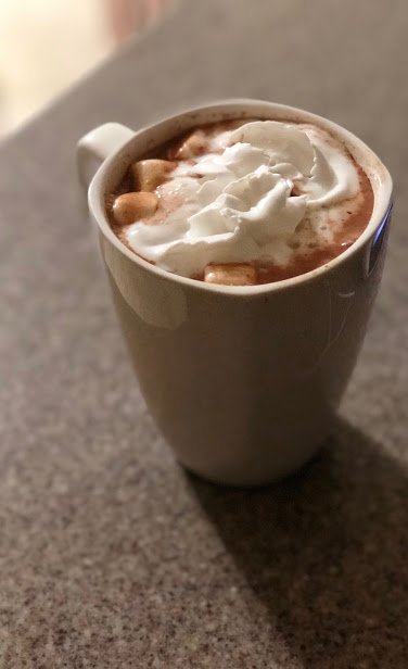 Hot cocoa sitting on granite counter for winter holiday tradition