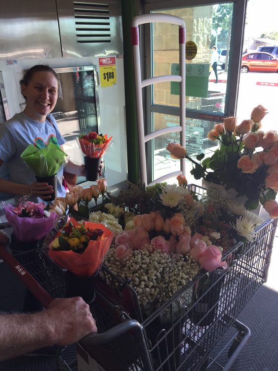 lady with a shopping cart full of flowers for DIY Floral arrangements