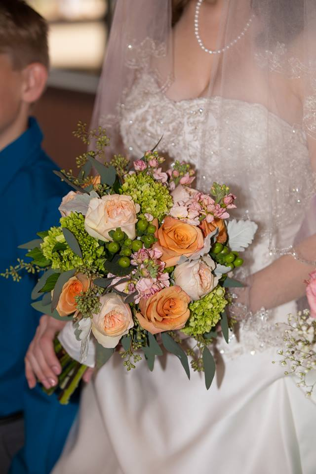Bride holding fall wedding floral bouquet