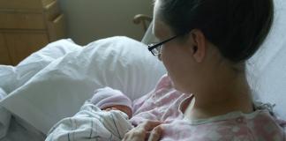 natural birth mom holding newborn