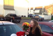 Valentines Day Heart of Balloons on Car with woman sniffing flowers