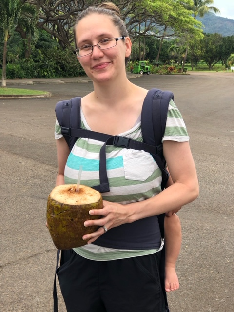 maui travel guide woman holding coconut water at tropical plantation