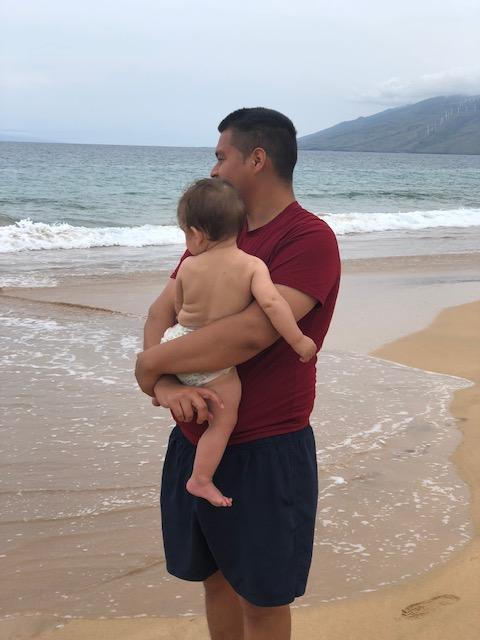 maui travel guide wailea Makena beach man holding baby looking at ocean